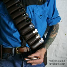 Model wearing Pinegrove Leather harmonica bandolier for 10 blues harps