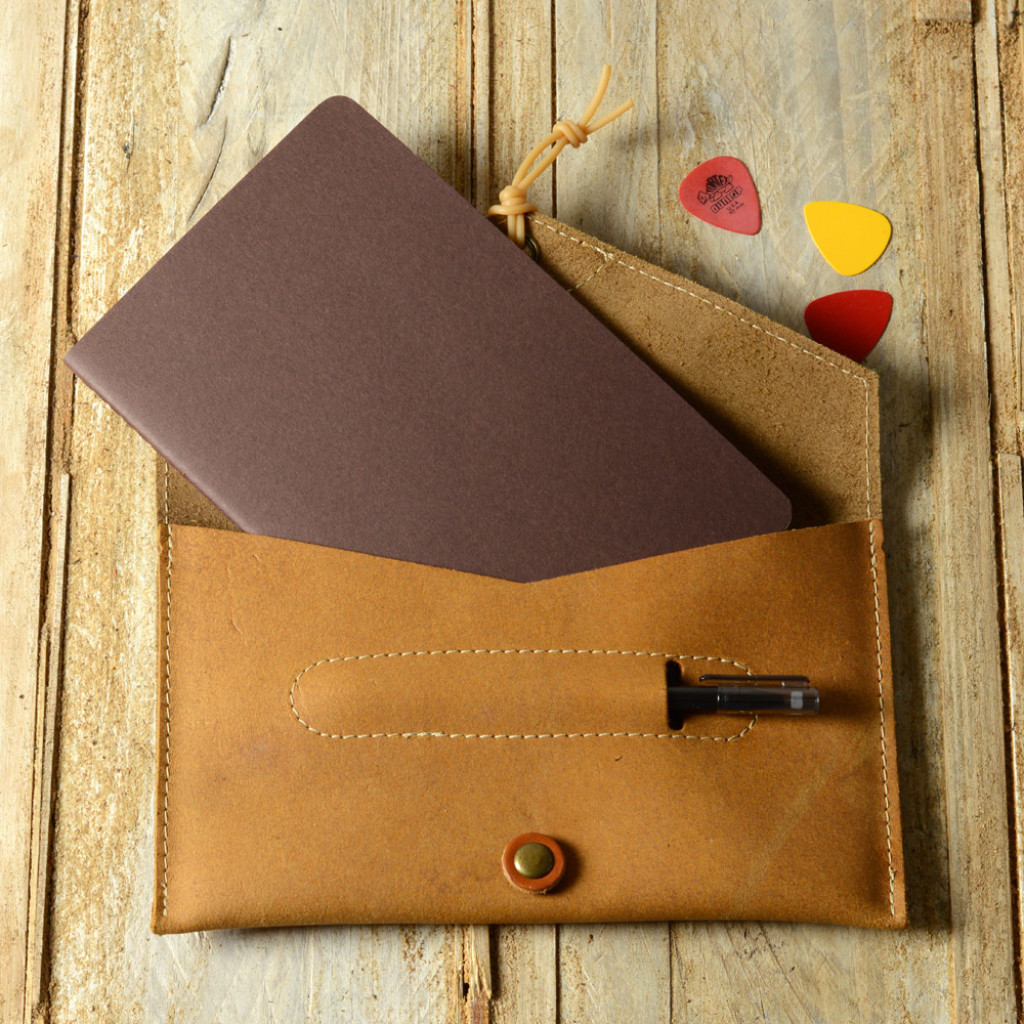 Pinegrove Leather Songwriter's Notebook Case, open, with a Moleskine notebook and pen